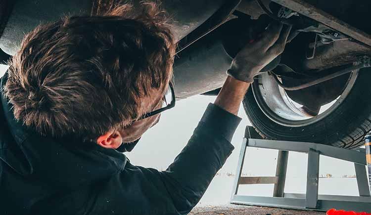 man-fixing-vehicle-engine-2244746