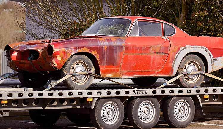 red-coupe-on-flatbed-trailer-943930